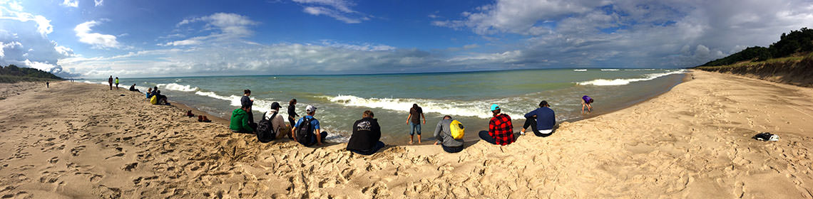 Students at the shores of Lake Michigan